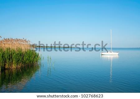 Sailboat on Lake Balaton in summer time - stock photo