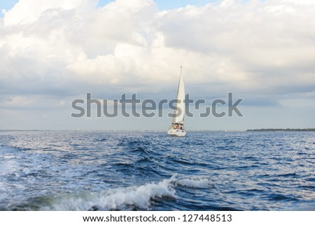 Sailboat on Port Charlotte Harbor, Florida,  in January. - stock photo