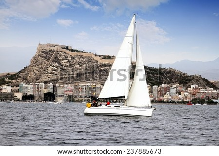 Sailboat sailing close to Alicante city - stock photo