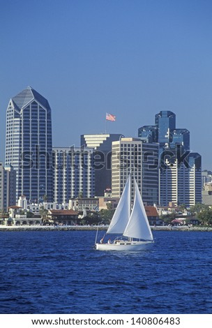 Sailboat sails in view of the San Diego skyline as seen from Coronado, San Diego, California - stock photo