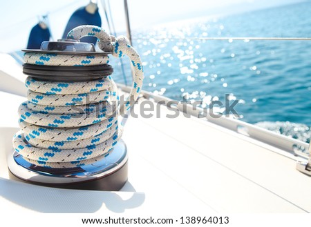 Sailboat winch and rope yacht detail. Yachting - stock photo