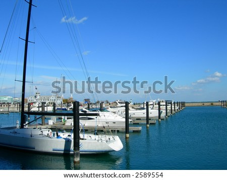Sailboats aligned in Chicago harbor - stock photo