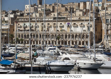 sailboats and waterfront of Senglea marina in front Vittoriosa, Malta - stock photo