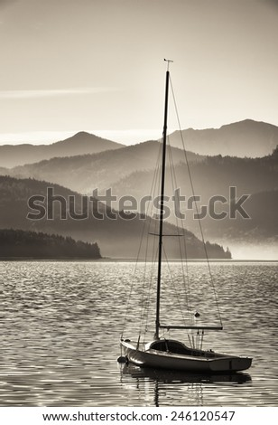 sailboats at the walchen lake in germany in front of the european alps - stock photo