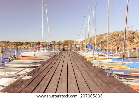 Sailboats docked in the rocky island harbor of Branno, near Goteborg (Gothenburg), Sweden. - stock photo