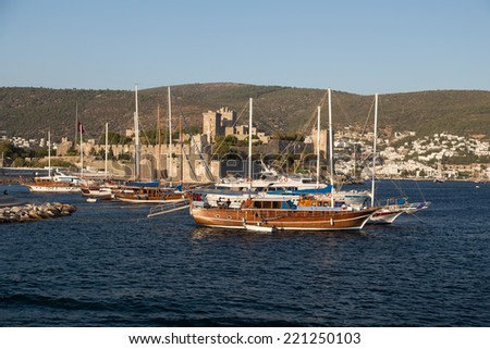 Sailboats in front of Bodrum Castle in Aegean Turkey - stock photo