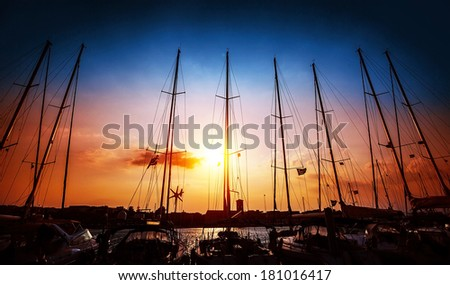 Sailboats mast on beautiful sunset background, harbor for sail yacht in the night, old marina in European city, travel and tourism concept - stock photo