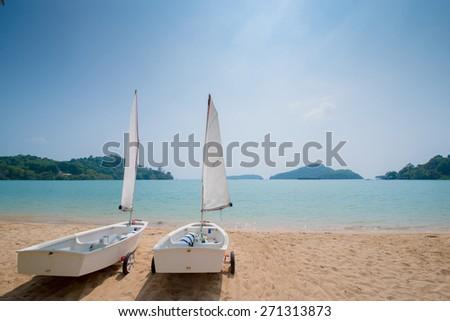 sailboats on beach - stock photo