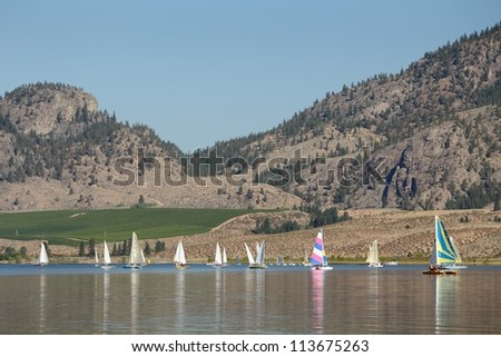 Sailboats on Osoyoos Lake in the South Okanagan, British Columbia, Canada. - stock photo