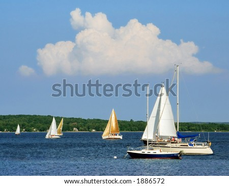 Sailboats on the blue water of Grand Traverse Bay, Michigan - stock photo