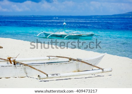 Sailboats on the white beach in the Philippines. - stock photo