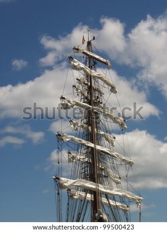 Sailing against a blue sky mast - stock photo
