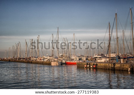 Sailing and engine boats moored in the harbour channel of Cervia in Northern Italy on the Adriatic Sea - stock photo