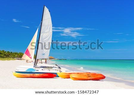 Sailing boat (catamaran) and kayaks at Varadero beach in Cuba - stock photo