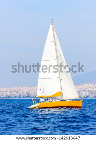 Sailing boat during a regatta out of Poros island in Greece - stock photo
