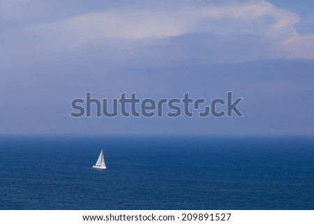 Sailing boat in open blue sea, top view  - stock photo