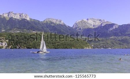 Sailing boat on peaceful lake in the Alps, Europe - stock photo