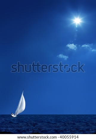 Sailing boat on the sea and blue sky - stock photo
