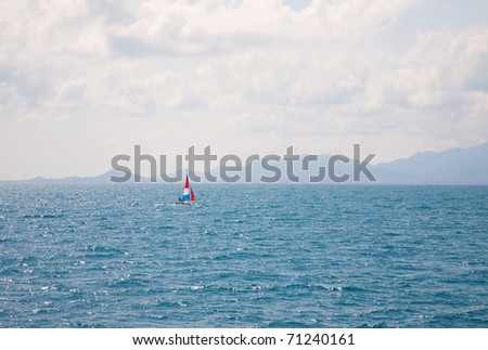 Sailing Boat Yacht Racing At Full Power - stock photo