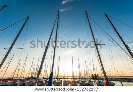 Sailing boats in the harbor at summer - stock photo