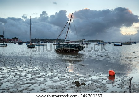 Sailing boats moored in the harbour at Sandbanks in Poole on the Dorset coast - stock photo