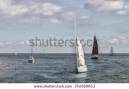 Sailing boats on a lake in the Netherlands - stock photo