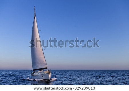Sailing in the dusk in the Aegean sea, Greece - stock photo