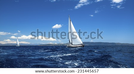 Sailing in the wind through the waves. - stock photo