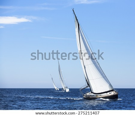 Sailing in the wind through the waves at the Aegean Sea in Greece. Luxury yachts.  - stock photo