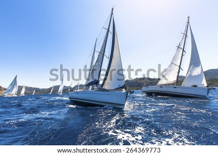 Sailing in the wind through the waves at the Aegean Sea in Greece. Sailing regatta. Luxury yachts.  - stock photo