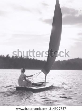 Sailing on a lake - stock photo