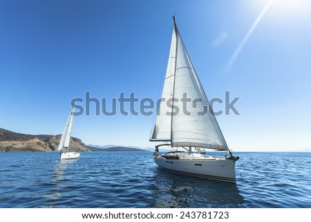 Sailing regatta. Luxury yachts. Sailing in the wind through the waves at the Aegean Sea in Greece.  - stock photo