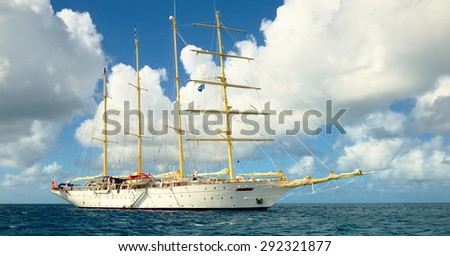 Sailing. Sailing ship with white sails in the open Sea. Luxury boats. - stock photo