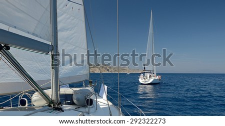 Sailing. Sailing yachts  with white sails in the open Sea. Luxury boats. - stock photo