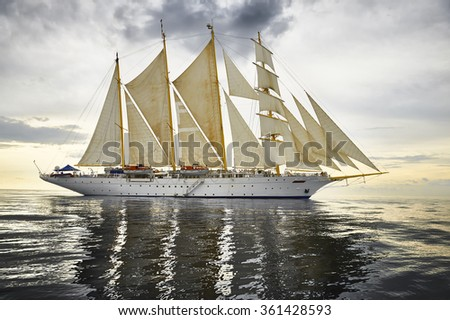 Sailing ship and a beautiful seascape at sunset.  Yachting. Sailing - stock photo