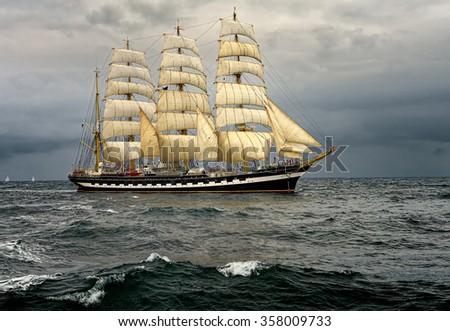 Sailing ship in storm ocean. Sail. Yachting. Sailing - stock photo