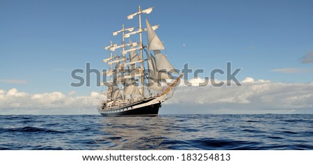 Sailing ship in the beautiful sea and sky. Collection ships and yachts - stock photo