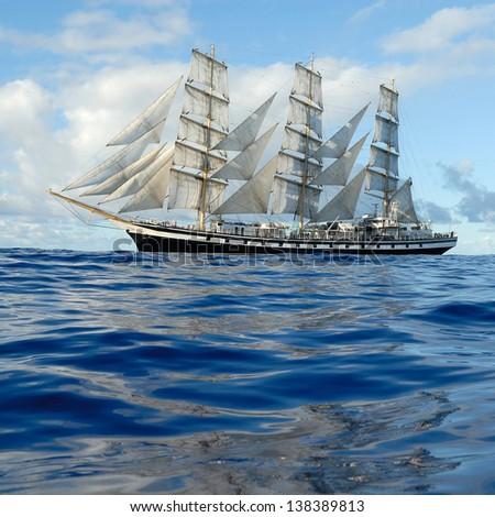 Sailing ship in the open ocean - stock photo