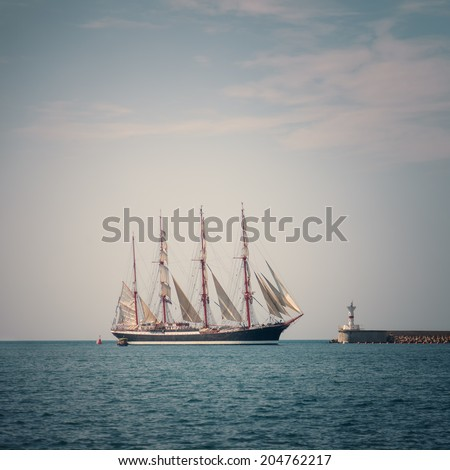 Sailing ship in the sea under the blue sky - stock photo
