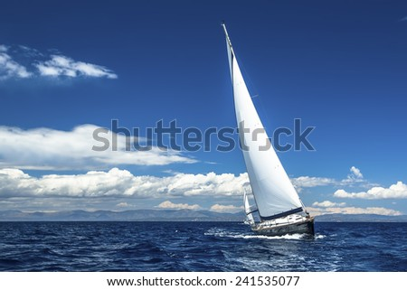 Sailing. Ship yachts with white sails in the open Sea. Luxury boats. - stock photo