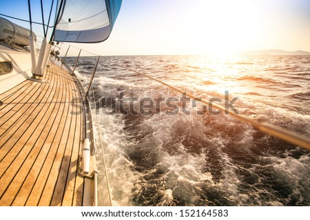 Sailing to the Sunrise. Luxury yacht. - stock photo