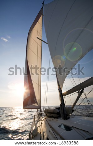 sailing towards sunset - stock photo