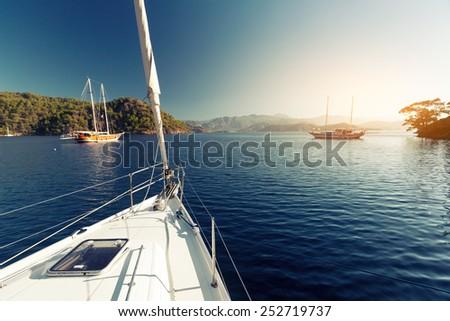 Sailing vessel anchored in calm bay. Aegean Sea, Turkey - stock photo