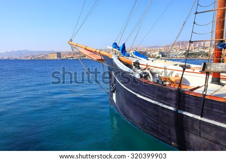Sailing vessel floating by Red sea on the Eilat city background (Israel) - stock photo