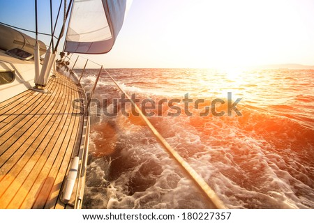 Sailing yacht against sunset. Luxury yachts. - stock photo