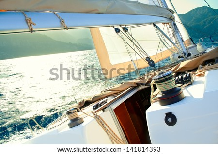 sailing yacht at a speed swims to shore - stock photo