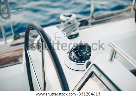 Sailing yacht control cockpit, wheel and implement.  - stock photo