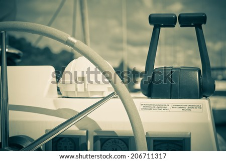 Sailing yacht control wheel and implement. Horizontal filtered shot without people - stock photo