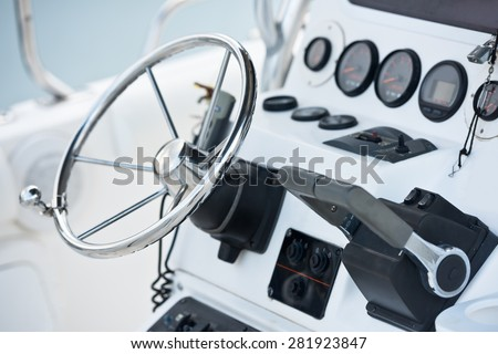 Sailing yacht control wheel and navigation implement. Horizontal shot without people - stock photo
