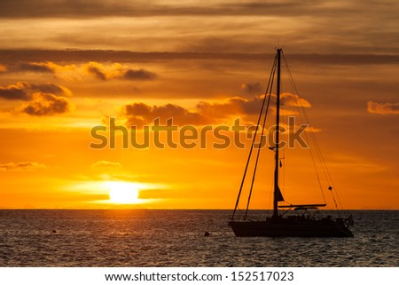 Sailing Yacht in the sea at sunset - stock photo